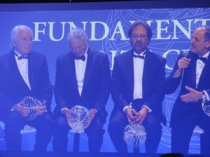 Physicists aren't accustomed to awards. From left to right: CERN special prize recipients Lyn Evans, Michel Della Negra, Tejinder Singh Virdee, Peter Jenni. Not shown: Guido Tonelli, Joe Incandela, and Fabiola GionottiPhoto: PK Read