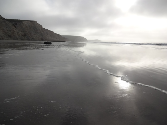 Sun through the fog on Drake's Beach, Caliorrnia Photo: PK Read