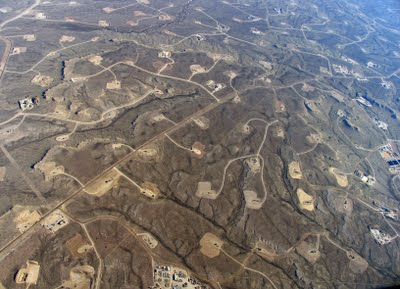 Natural-gas wells on public land in the Jonah Field of western Wyoming. Fracking is routine for most gas wells drilled now in the U.S.  Photo: EcoFlight via SkyTruth