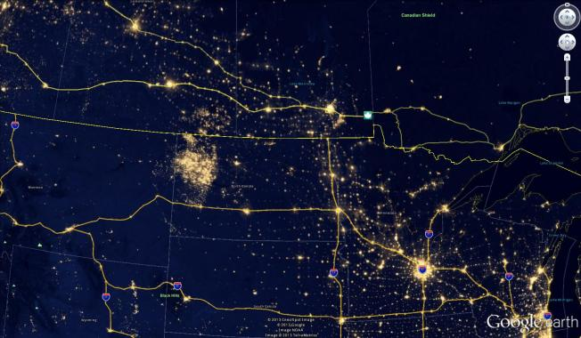 An image of the Bakken Shale area, the large glow on the upper left, by night. The lights are from the fracking and oil extraction sites. Image: NASA via jad.blog