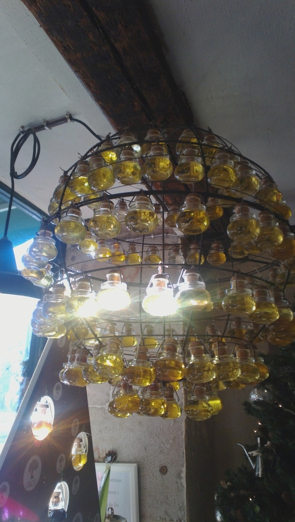 A chandelier of olive oil jars, seen in Geneva Old Town. Photo: PK Read