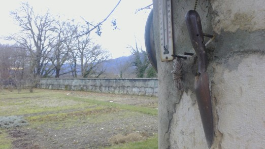 Ever-ready trowel at the gate to the farm kitchen garden next door. Photo: PK Read