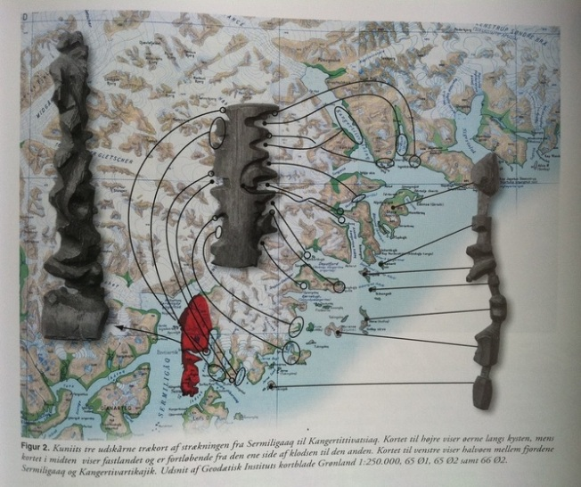 "In English, the caption reads: ""Kuniit's three wooden (tree) maps show the journey from Sermiligaaq to Kangertittivatsiaq. Map to the right shows the islands along the coast, while the map in the middle shows the mainland and is read from one side of the block around to the other. Map to the left shows the peninsula between the fjords Sermiligaaq and Kangertivartikajik."" Source: Topografisk Atlas Grønland via Nuuk Marlak"